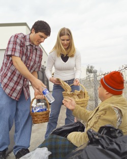 Teens helping homeless man
