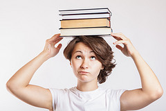 Image: Girl balancing books on head