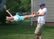 Image: Father swinging daughter